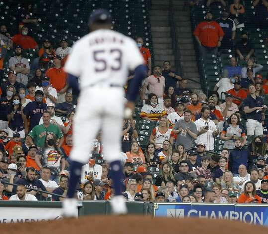 Fans cheer on Houston Astros starting pitcher Cristian Javier (53) as he pitched during the fifth inning of the Astros home opener MLB baseball game at Minute Maid Park, in Houston, Thursday, April 8, 2021. Photo: Karen Warren/Staff Photographer / @2021 Houston Chronicle