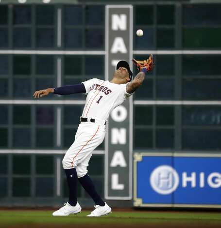 Houston Astros shortstop Carlos Correa (1) catches Oakland Athletics catcher Sean Murphy's pop out during the fourth inning of the Astros home opener MLB baseball game at Minute Maid Park, in Houston, Thursday, April 8, 2021. Photo: Karen Warren/Staff Photographer / @2021 Houston Chronicle