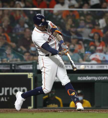 Houston Astros Carlos Correa (1) hits an RBI double during the fourth inning of the Astros home opener MLB baseball game at Minute Maid Park, in Houston, Thursday, April 8, 2021. Photo: Karen Warren/Staff Photographer / @2021 Houston Chronicle