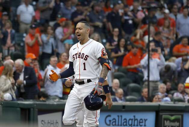 Houston Astros shortstop Carlos Correa (1) celebrates his solo home during the second inning of the Astros home opener MLB baseball game at Minute Maid Park, in Houston, Thursday, April 8, 2021. Photo: Karen Warren/Staff Photographer / @2021 Houston Chronicle