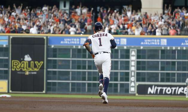 Houston Astros shortstop Carlos Correa (1) runs the bases after hitting his solo home run during the second inning of the Astros home opener MLB baseball game at Minute Maid Park, in Houston, Thursday, April 8, 2021. Photo: Karen Warren/Staff Photographer / @2021 Houston Chronicle