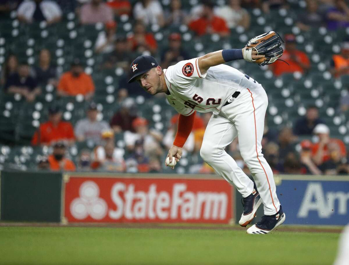 Houston Astros third baseman Alex Bregman (2) fields Oakland Athletics shortstop Elvis Andrus' ground out during the third inning of the Astros home opener MLB baseball game at Minute Maid Park, in Houston, Thursday, April 8, 2021.