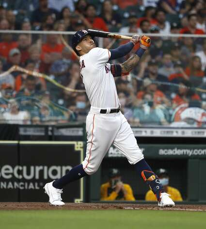 Houston Astros shortstop Carlos Correa (1) hits his solo home run during the second inning of the Astros home opener MLB baseball game at Minute Maid Park, in Houston, Thursday, April 8, 2021. Photo: Karen Warren/Staff Photographer / @2021 Houston Chronicle