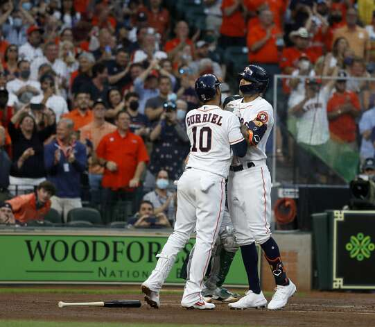 Houston Astros shortstop Carlos Correa (1) celebrates his solo home run with Yuli Gurriel (10) during the second inning of the Astros home opener MLB baseball game at Minute Maid Park, in Houston, Thursday, April 8, 2021. Photo: Karen Warren/Staff Photographer / @2021 Houston Chronicle