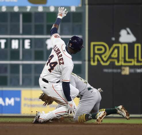 Houston Astros left fielder Yordan Alvarez (44) slides into second base against Oakland Athletics second baseman Tony Kemp (5) after his double during the fourth inning of the Astros home opener MLB baseball game at Minute Maid Park, in Houston, Thursday, April 8, 2021. Photo: Karen Warren/Staff Photographer / @2021 Houston Chronicle