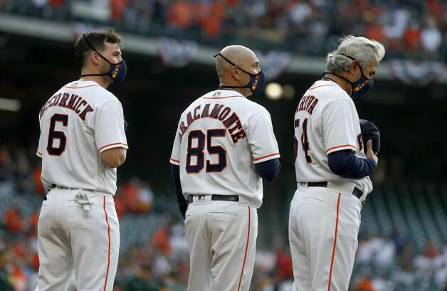 Houston Astros Chas McCormick (6), bullpen catcher Javier Bracamonte (85), and Dan Firova (54) during a moment of silence after player introductions before the start of the first inning of the Astros home opener MLB baseball game at Minute Maid Park, in Houston, Thursday, April 8, 2021. Photo: Karen Warren/Staff Photographer / @2021 Houston Chronicle