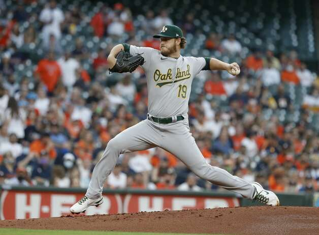 Oakland Athletics starting pitcher Cole Irvin (19) pitches during the first inning of the Astros home opener MLB baseball game at Minute Maid Park, in Houston, Thursday, April 8, 2021. Photo: Karen Warren/Staff Photographer / @2021 Houston Chronicle