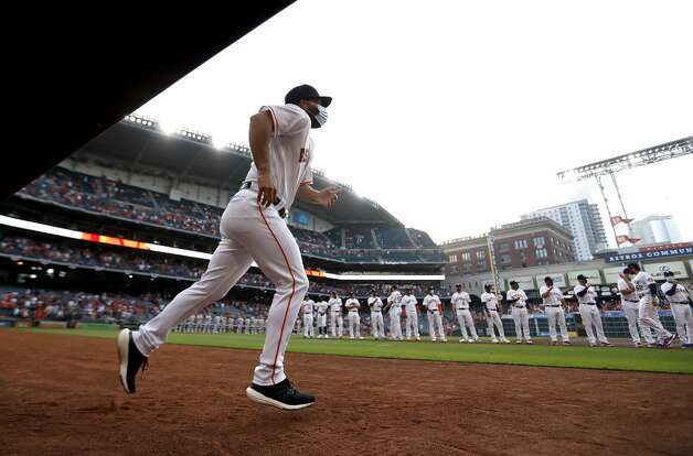 Houston Astros starting pitcher Jose Urquidy (65) runs onto the field during player lineups before the start of the Astros home opener MLB baseball game at Minute Maid Park, in Houston, Thursday, April 8, 2021. Photo: Karen Warren/Staff Photographer / @2021 Houston Chronicle