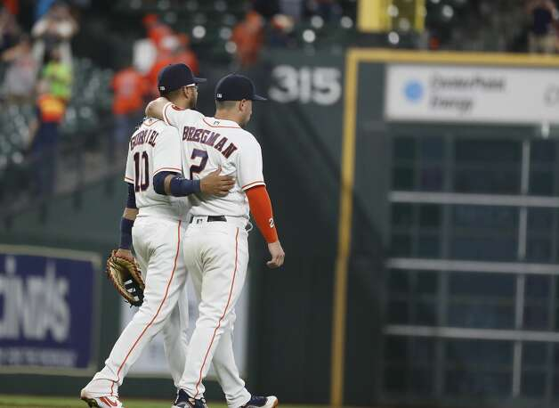 Houston Astros third baseman Alex Bregman (2) hugs first baseman Yuli Gurriel (10) after the Astros 6-2 win over the Oakland Athletics in the Astros home opener MLB baseball game at Minute Maid Park, in Houston, Thursday, April 8, 2021. Photo: Karen Warren/Staff Photographer / @2021 Houston Chronicle