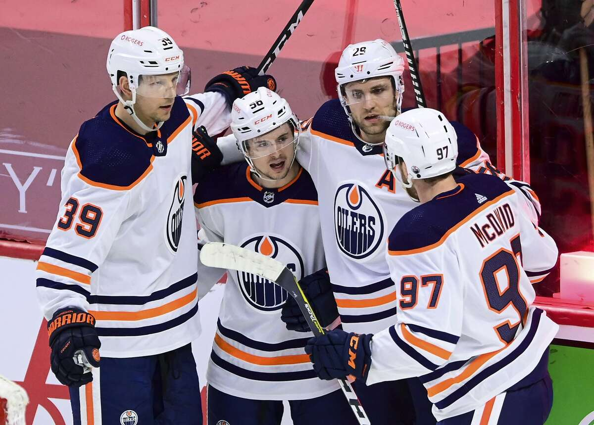 Edmonton Oilers' Kailer Yamamoto, second from left, celebrates a goal against the Ottawa Senators with Alex Chiasson, Leon Draisaitl and Connor McDavid, from left, during the second period of an NHL hockey game Thursday, April 8, 2021, in Ottawa, Ontario. (Sean Kilpatrick/The Canadian Press via AP)