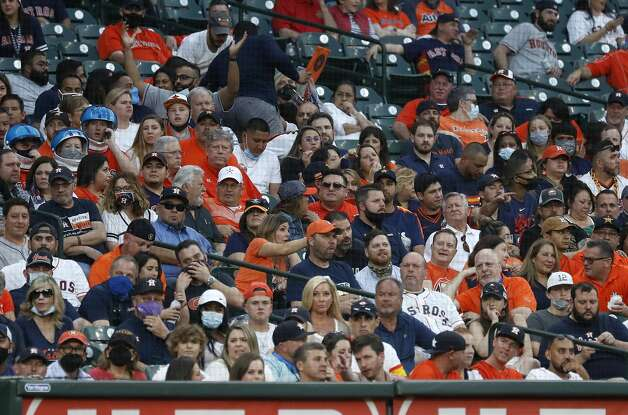 Fans in the stands during the first inning of the Astros home opener MLB baseball game at Minute Maid Park, in Houston, Thursday, April 8, 2021. Photo: Karen Warren/Staff Photographer / @2021 Houston Chronicle