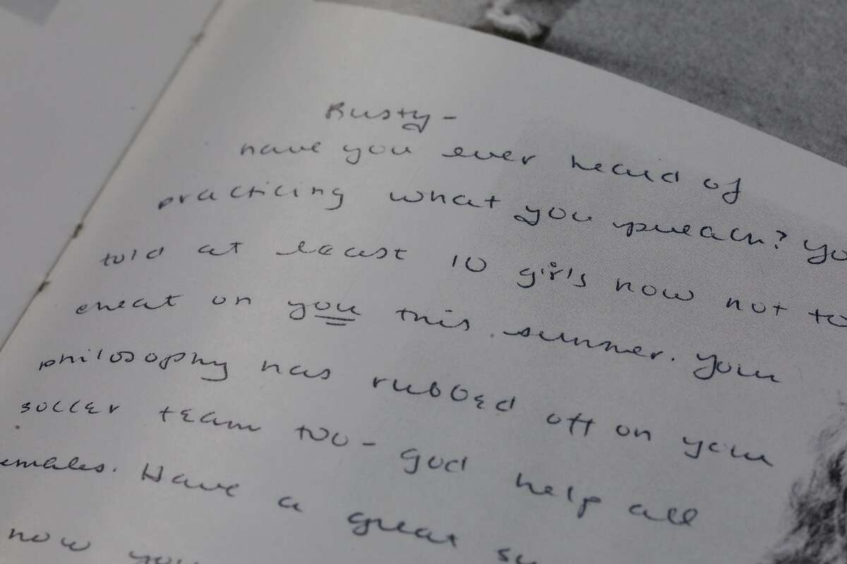 A note in a yearbook from Daphne Greene's high school where someone writes about her former coach Rusty Taylor and his treatment of girls.
