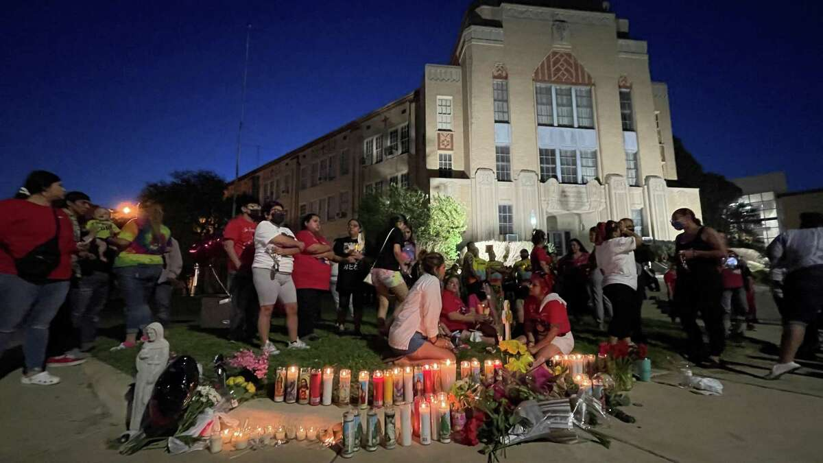 """Cyclists joined family and friends Thursday to mourn the death of Beatrice """"Bea"""" Gonzalez, 43. About 200 people showed up for the vigil in front of Central Catholic High School, where she was killed in what police said was a drunken driving incident."""