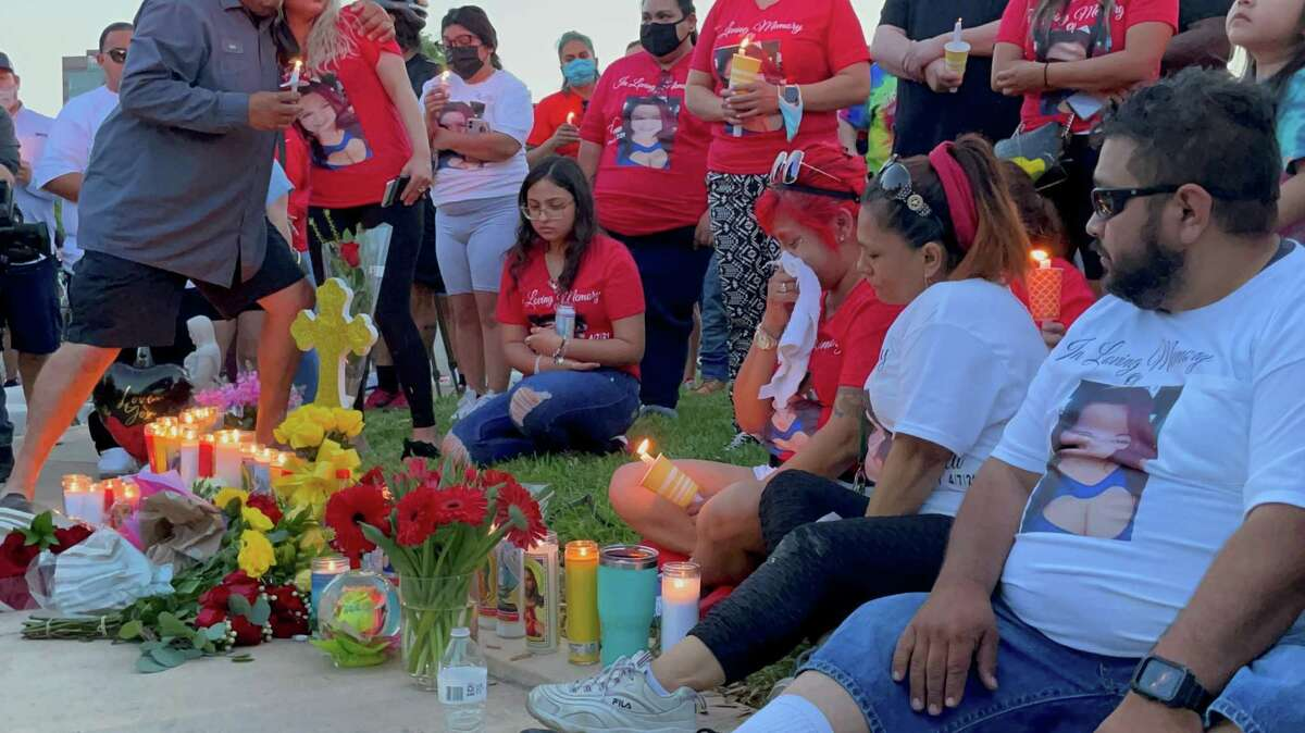 """About 200 cyclists, friends and family members attend a Thursday evening vigil for Beatrice """"Bea"""" Gonzalez, 43, who was killed while riding with her bike group."""