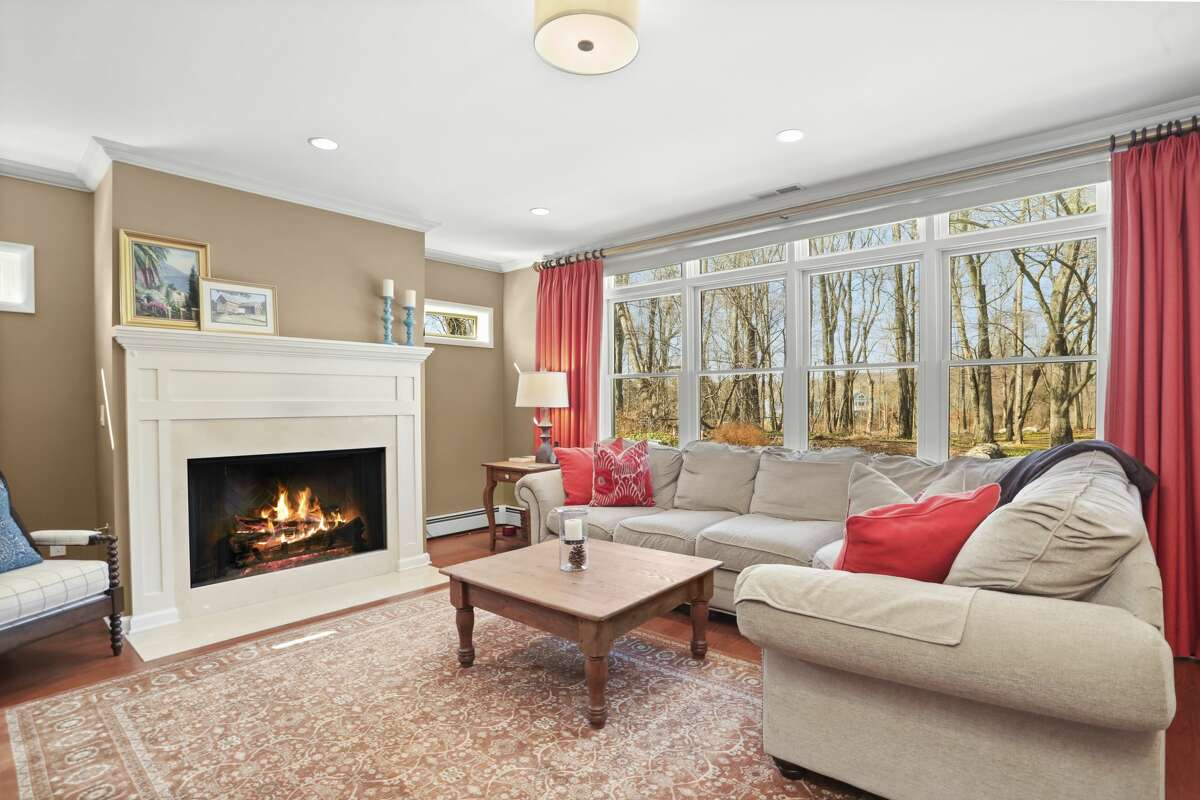 Living room with gas fireplace at 14 Wood Hill Road, Weston.
