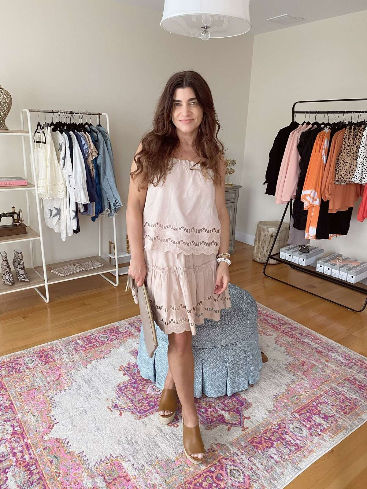 """Melissa Mallone opened her boutique, """"Plain and Fancy,"""" right before the pandemic started in March 2020. Now, she sells clothes from the store space in her home."""