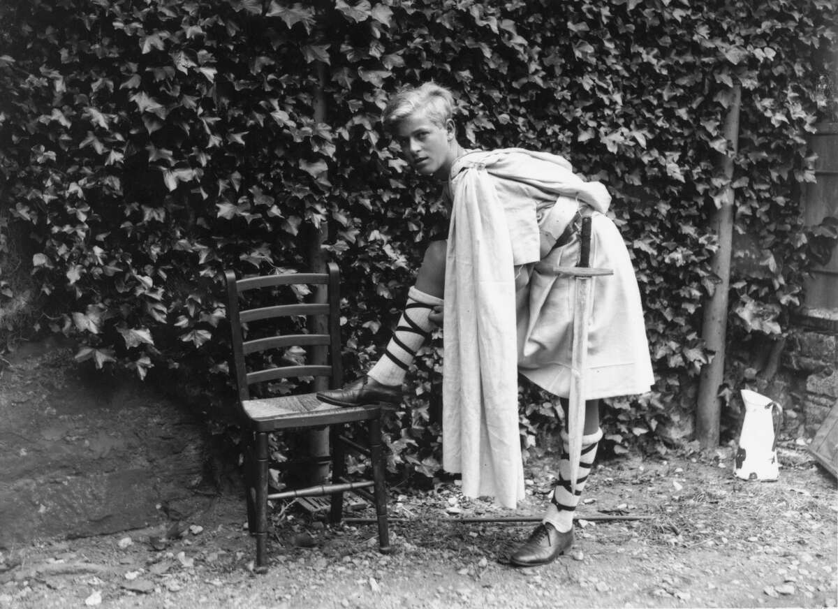July 1935: Prince Philip of Greece dressed for the Gordonstoun School's production of 'MacBeth', in Scotland. (Photo by Fox Photos/Getty Images)