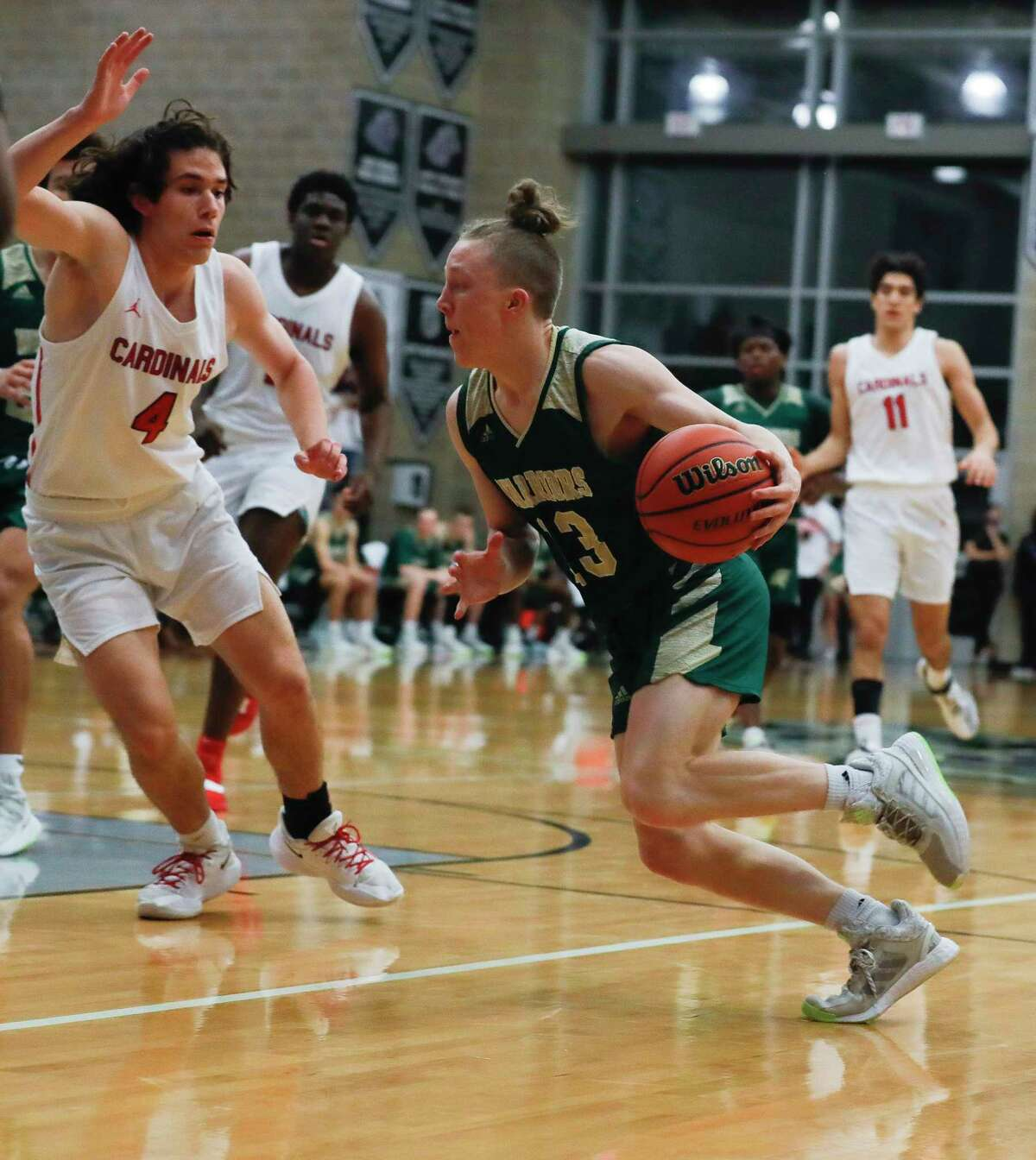 The Woodlands Christian Academy's Austin Benigni (13) drives to the basket against Fort Worth Christian's Nathan Bledsoe (4) during the first quarter of a TAPPS Class 5A state championship game at College Station High School, Friday, March 12, 2021, in College Station.