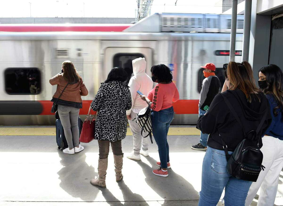 Passengers wait to board a Metro-North train bound for Grand Central Terminal at the Stamford Transportation Center in Stamford, Conn. Wednesday, April 7, 2021. Ridership has been slowly increasing recently but is still down 78 percent from pre-pandemic levels.
