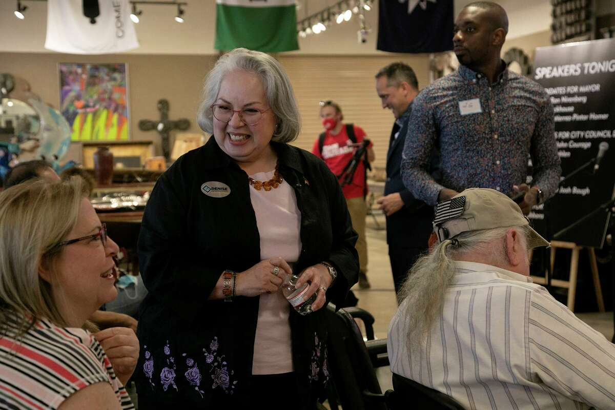 Mayoral candidate Denise Gutierrez-Homer, center, talks with Ellen Boyer, left, before the Greater Harmony Hills Neighborhood Association's Candidate Debate Night at Vogt Auction House in San Antonio on April 8, 2021.
