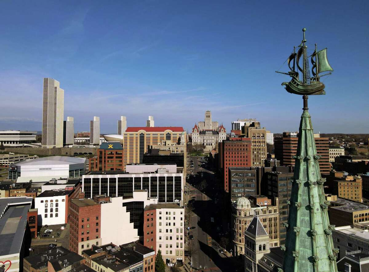 The Albany skyline and Half Moon weathervane atop the former Delaware & Hudson Building, now SUNY Plaza, as seen from above Frontage Road.