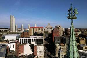 The Albany skyline and Half Moon weathervane atop the former Delaware & Hudson Building, now SUNY Plaza, is seen from above Frontage Road on Friday, April 9, 2021, in Albany, N.Y. (Will Waldron/Times Union)