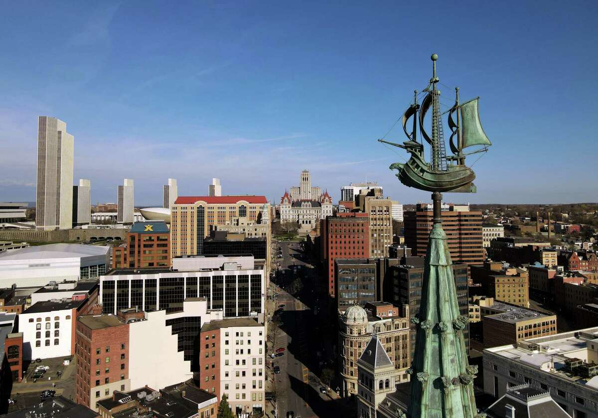 The Albany skyline and Half Moon weathervane atop the former Delaware & Hudson Building, now SUNY Plaza, is seen from above Frontage Road on Friday, April 9, 2021, in Albany, N.Y. The latest Census county puts Albany at 776 people under 100,000. (Will Waldron/Times Union)