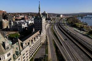 I-787 and the former Delaware & Hudson Building, now SUNY Plaza, is seen from above Frontage Road on Friday, April 9, 2021, in Albany, N.Y. (Will Waldron/Times Union)