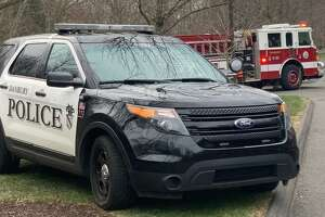 A Danbury police investigation is underway after a dead body was found submerged in water outside a Mill Plain Road condominium complex Thursday night.