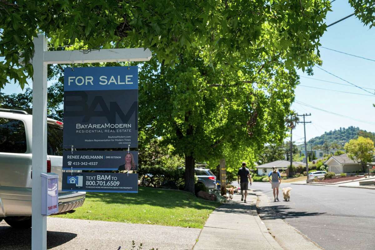 A For Sale sign in front of a single family home in San Rafael, Calif., on June 8, 2020.