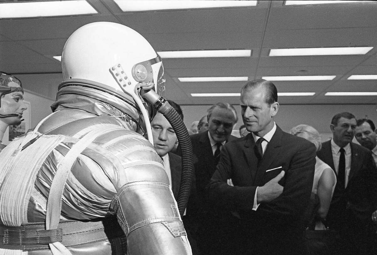 03/11/1966 - Prince Philip, Duke of Edinburgh, gets a closer look at a spacesuit during his tour of the Manned Spacecraft Center in Houston.