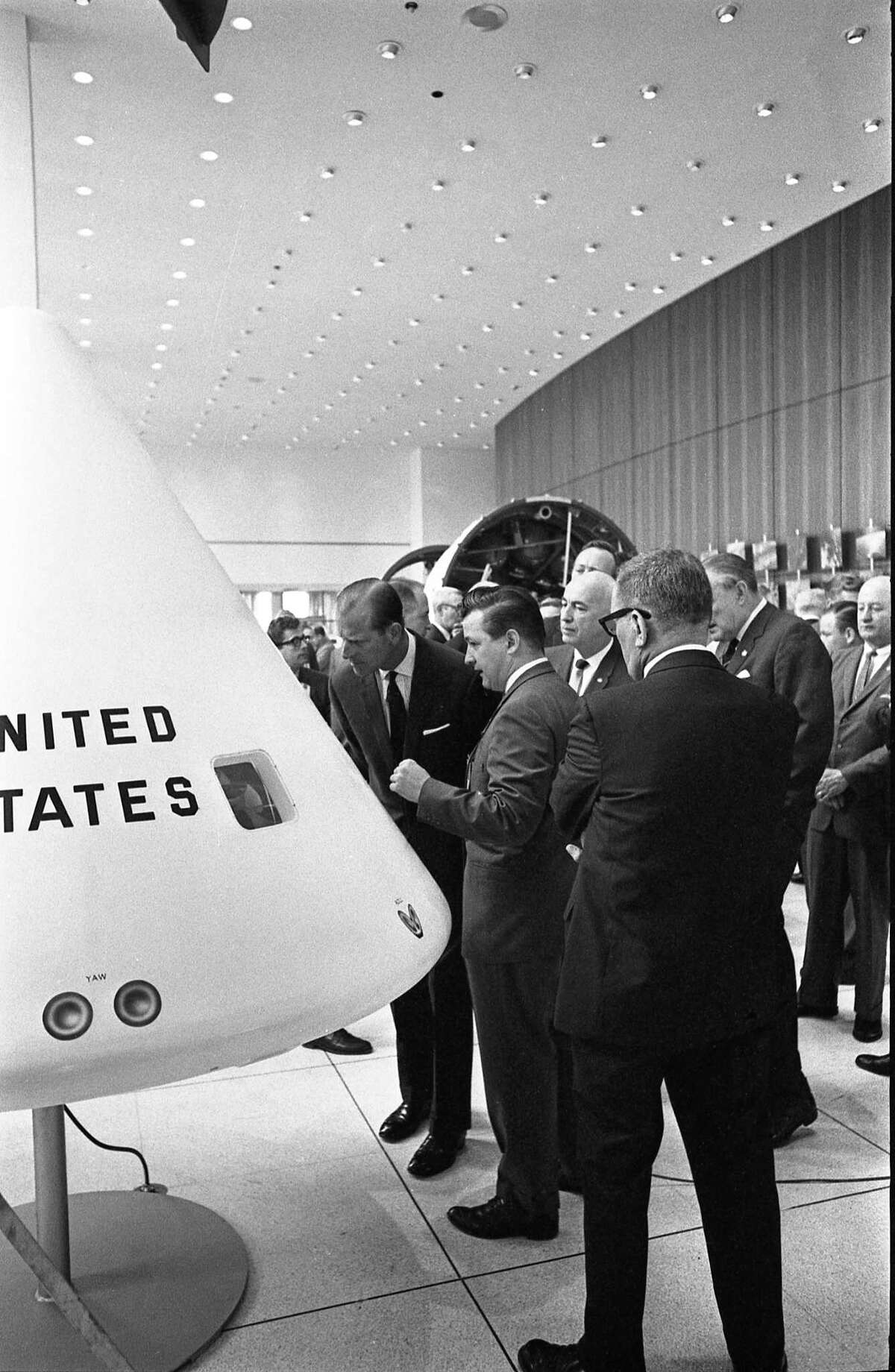 03/11/1966 - Prince Philip, Duke of Edinburgh, is briefed on spacecraft during tour of the Manned Spacecraft Center in Houston.