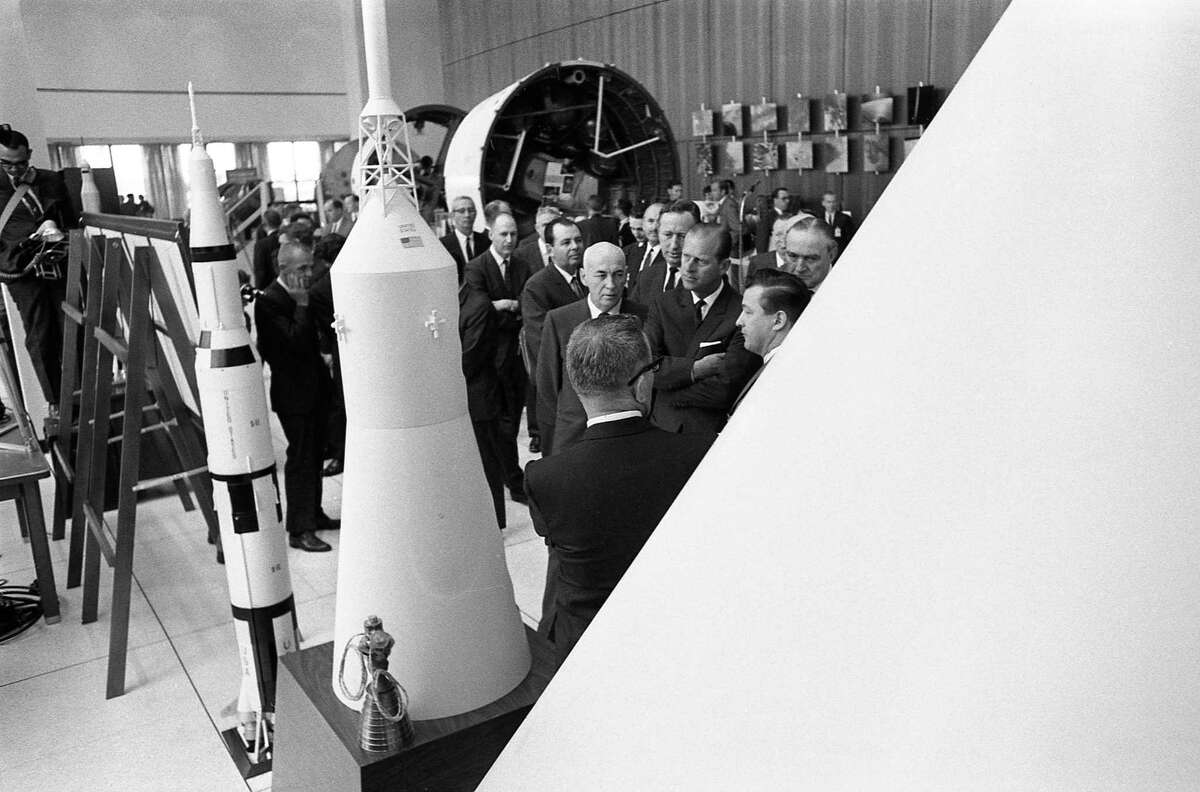 03/11/1966 - Prince Philip, Duke of Edinburgh, is briefed on rockets while viewing models during tour of the Manned Spacecraft Center in Houston. MSC director Robert Gilruth stands at the Duke of Edinburgh's right.
