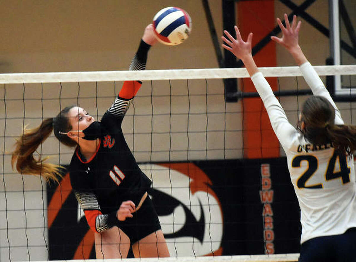 Edwardsville's Gabby Saye (left) hits past O'Fallon's block during the Tigers win in the championship match of the SWC Tournament on Thursday night at Lucco-Jackson Gym in Edwardsville. The 6-3 Saye had 17 kills and five blocks in the win.