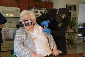 EMT and Paramedic James Mudge administers a COVID-19 vaccine in the arm of Mary Nardiello in her home on Friday, April 2, 2021 in Albany, N.Y. (Lori Van Buren/Times Union)