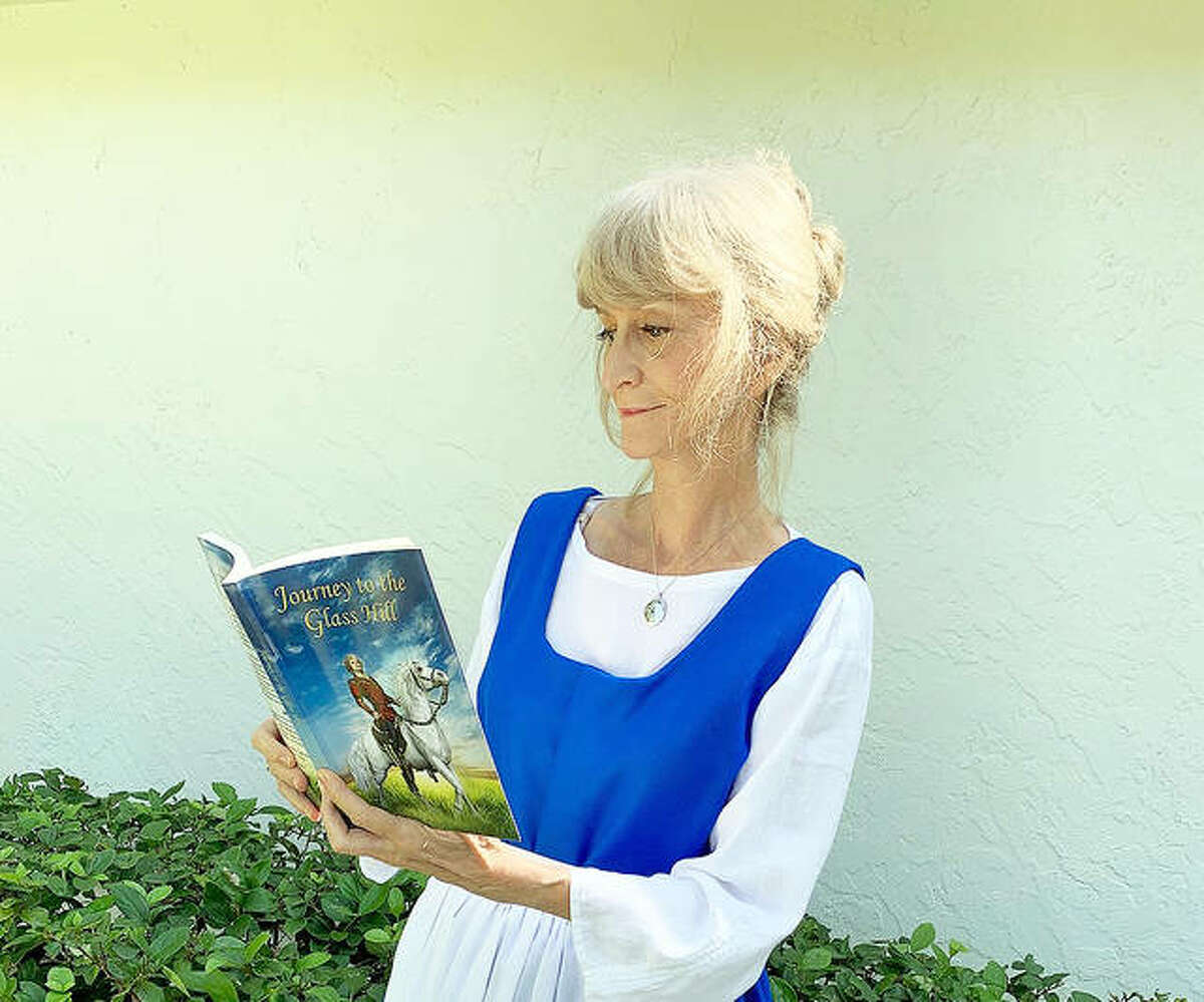 Diane Frazier, a retired kindergarten teacher from Glen Carbon, recently completed a trilogy of Christian historical fiction books aimed at middle-grade students. She is wearing a 1600s period costume that she hopes to wear to schools to talk about the books.