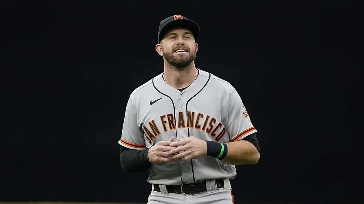 San Francisco Giants' Evan Longoria warms up before a baseball game against the Seattle Mariners, Saturday, April 3, 2021, in Seattle. (AP Photo/Ted S. Warren)