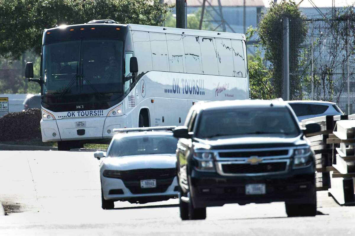 A bus carrying a group of migrant teenagers arrives to the grounds of the National Association of Christian Churches warehouse, on Friday, April 2, 2021, in Houston. A total of five hundred unaccompanied migrant teenage girls are expected to be housed at this facility.