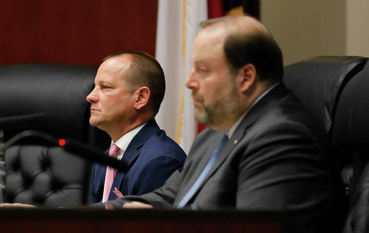 Conroe City Councilman Jody Czajkoski, left, and Councilman Duke Coon took different stances on the need for a new PR position for the city.