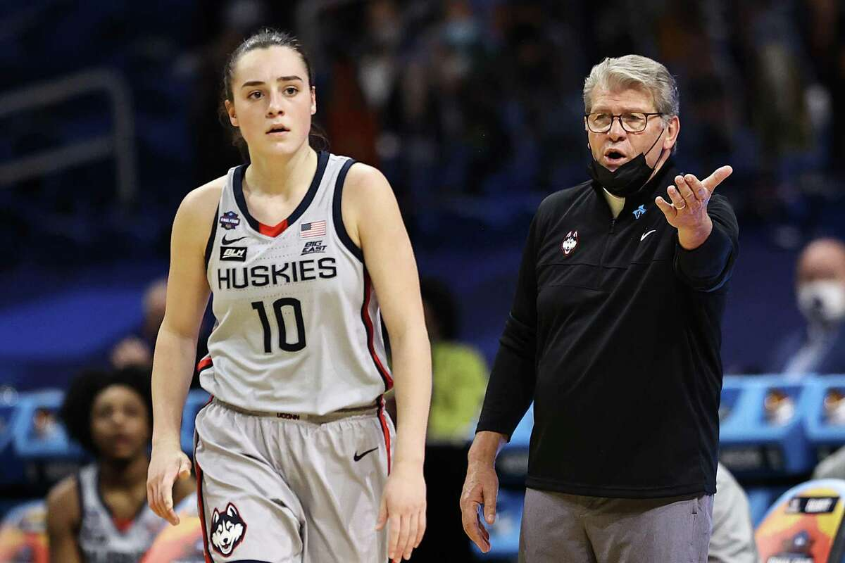 UConn's Geno Auriemma speaks with Nika Muhl during the third quarter in the Final Four semifinal game of the NCAA Tournament at the Alamodome on April 2 in San Antonio. UConn has extended Auriemma's contract through 2025 in a deal worth $15 million, athletic director David Benedict announced on Friday.