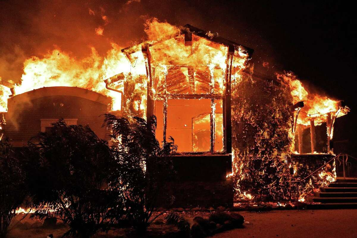 Soda Rock Winery erupts in flames after the Kincade Fire jumped Highway 128 outside Healdsburg (Sonoma County). The county has charged PG&E with emitting smoke and ash in connection with the fire.