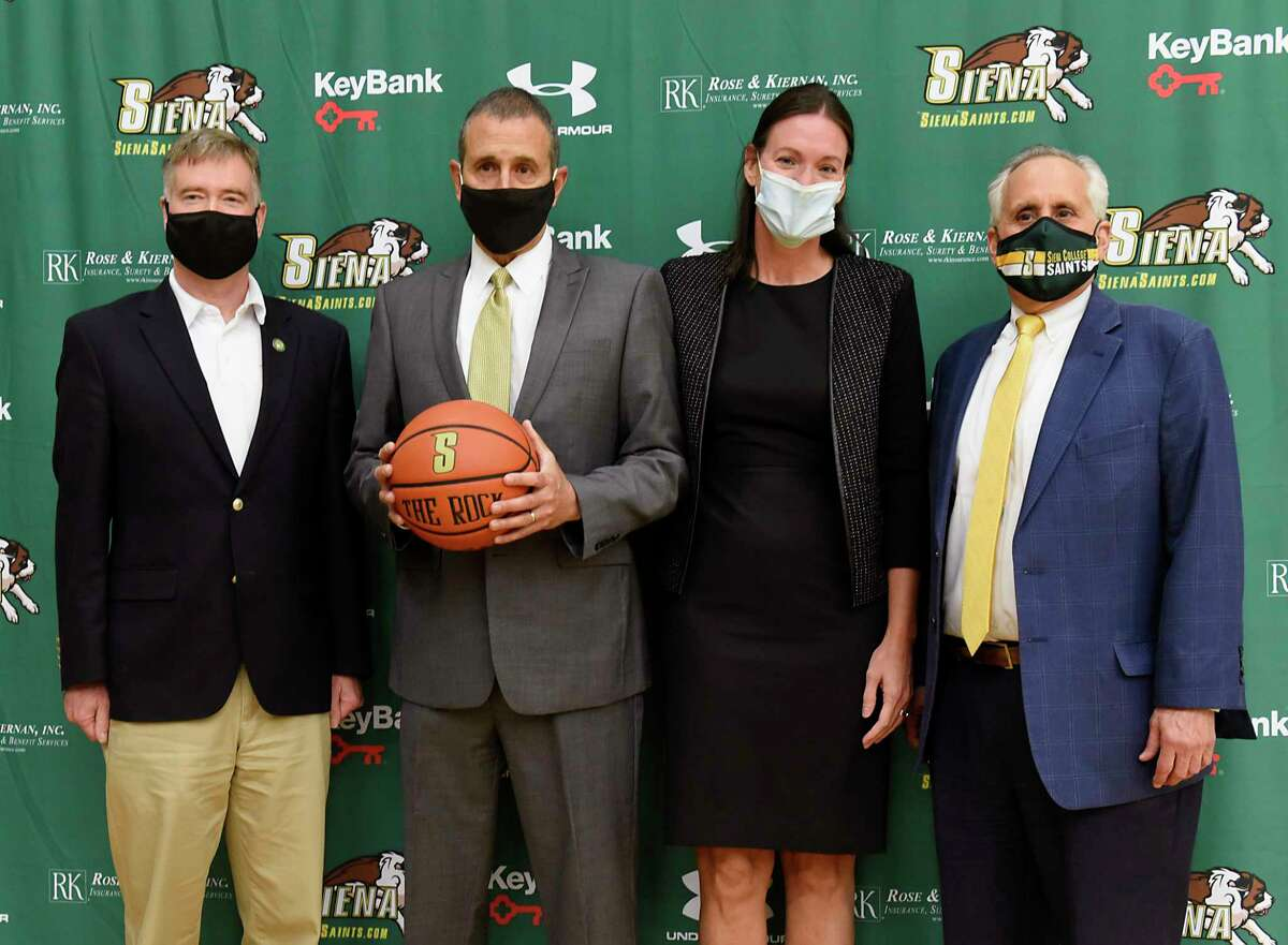 From left, Siena College President Chris Gibson, Jim Jabir, new Siena women's basketball head coach, wife Angie Jabir, and John D'Argenio, Siena College director of athletics, pose for a photo during a press conference on Thursday, April 8, 2021 in Loudonville, N.Y. Jabir coached Siena from 1987 to 1990. (Lori Van Buren/Times Union)
