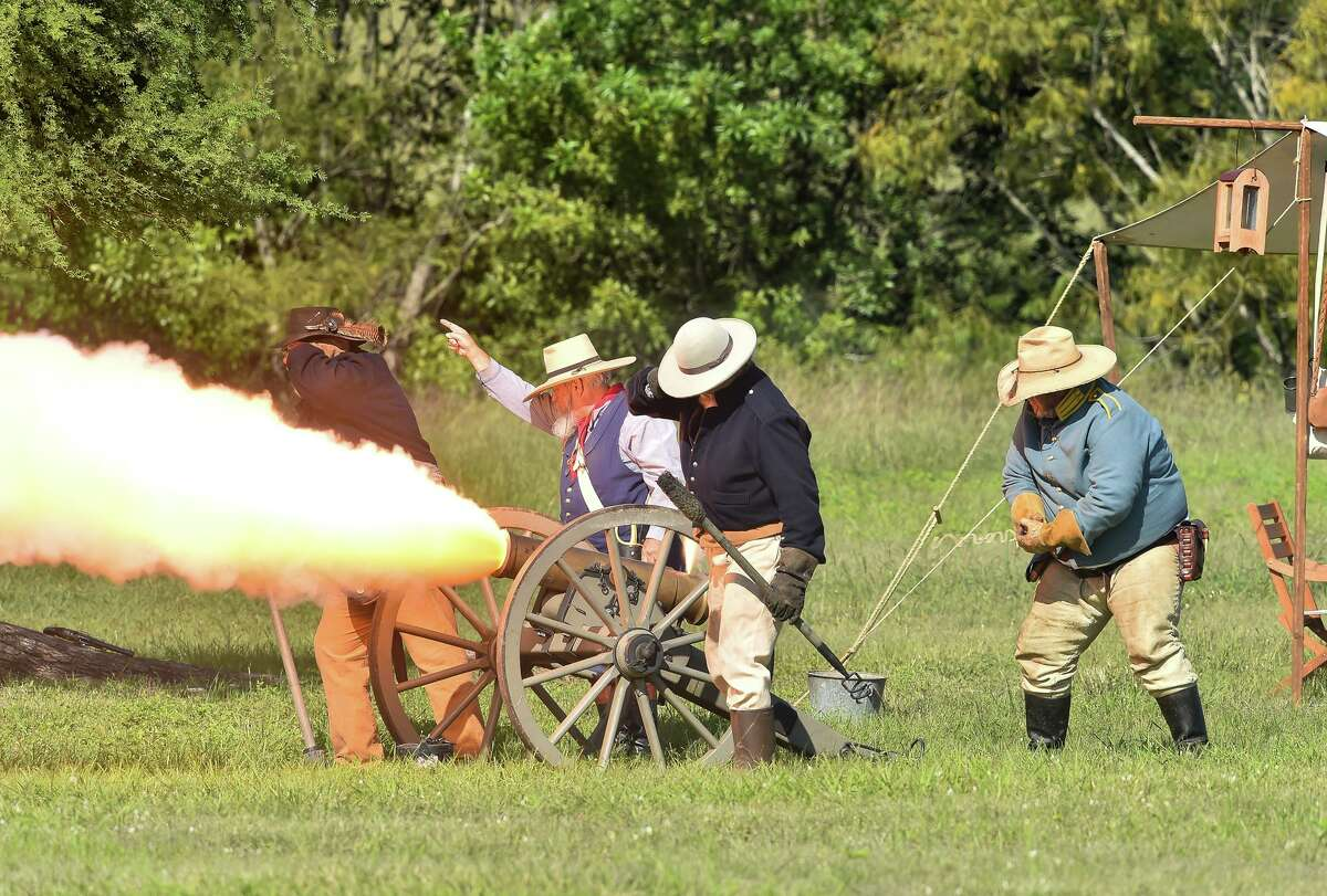 Re-enactors fire their canon during the San Antonio Living History Association re-enactment of the two opening battles of the Texas revolution on Oct. 27, 2018, in Kirby's Friendship Park.