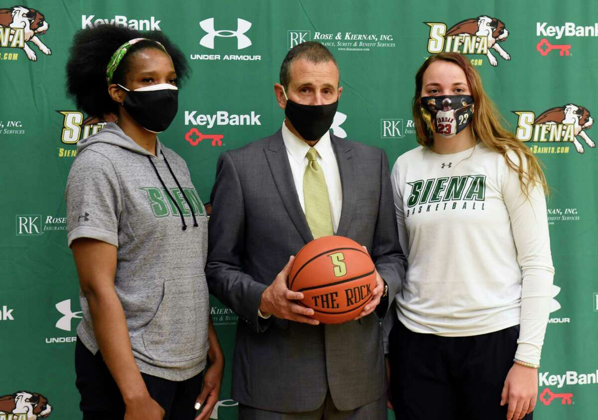 Jim Jabir, new Siena women's basketball head coach, poses with players Lala Watts, left, and Margo Peterson during a press conference on Thursday, April 8, 2021 in Loudonville, N.Y. Jabir coached Siena from 1987 to 1990. (Lori Van Buren/Times Union)