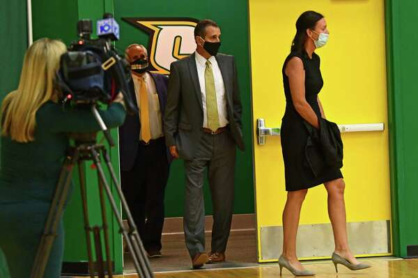 Jim Jabir, new Siena women's basketball head coach, enter the gym with his wife Angie Jabir, during a press conference on Thursday, April 8, 2021 in Loudonville, N.Y. John D'Argenio, Siena College director of athletics, follows behind him. Jabir coached Siena from 1987 to 1990. (Lori Van Buren/Times Union)