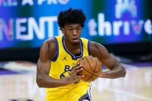 James Wiseman of the Golden State Warriors passes the ball against the Sacramento Kings on March 25, 2021.