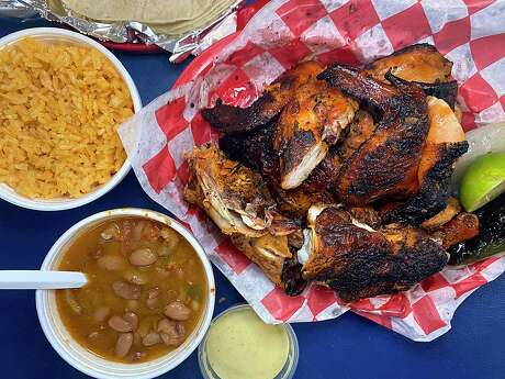 A whole grilled chicken at Al Carbon Pollos Asados on Culebra Road in San Antonio comes with rice, tortillas, salsa, grilled onion and roasted jalapeño, with charro beans as an add-on.