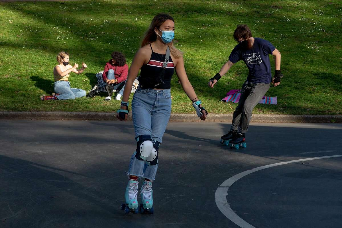 Roller skaters from across the Bay Area meet up at Skatin' Place in Golden Gate Park for a Friday night roller disco hosted by David Miles Jr., the Godfather of Skate, on April 2, 2021.