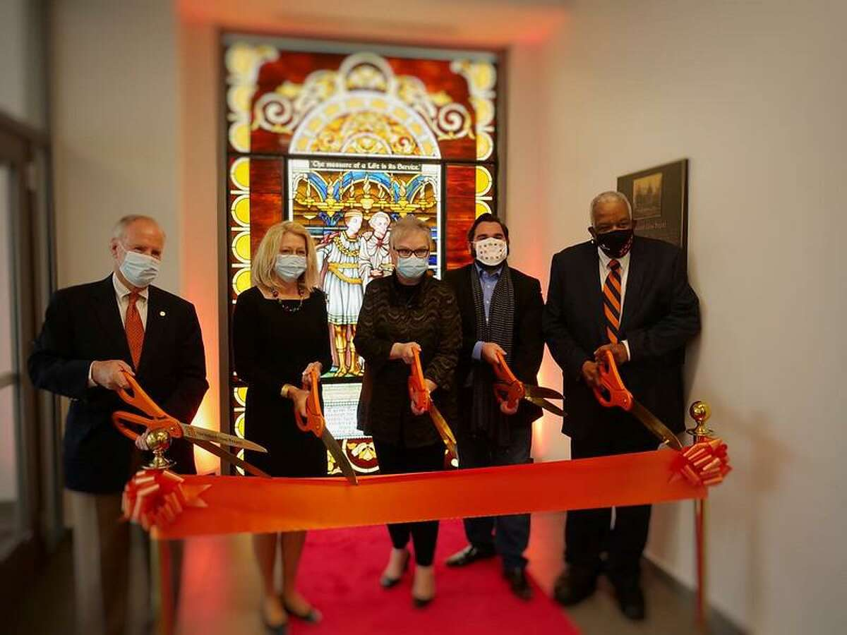 Officials with Sam Houston State University dedicate a recreated historic window at the Lowman Student Center on campus. The original window was in Old Main on campus and was destroyed in a 1982 fire.