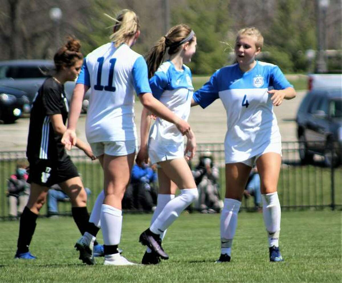 LCCC's Skylar Hollingshead (4), Chelsea Riden, center, and Candice Parziani celebrate a goal in their 5-0 season-opening victory over Triton. The No. 3-ranked Trailblazers will play host to No. 2 Eastern Florida State at 11 am. Sunday at Tim Rooney Stadium.